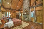 Master bedroom with a wood burning fireplace